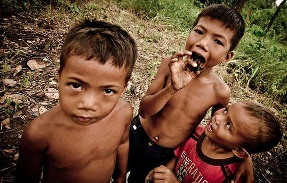 children-in-cambodia-eat-spiders