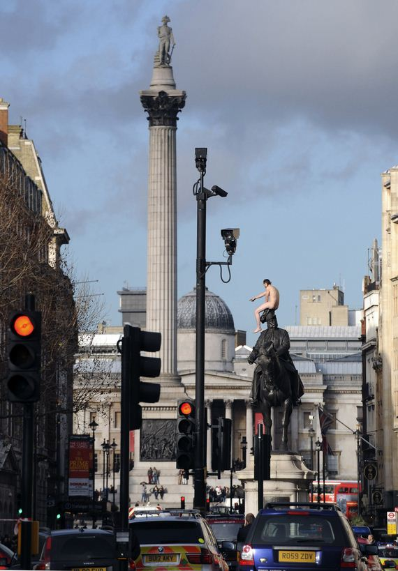 naked-man-sits-on-statue-in-central-london
