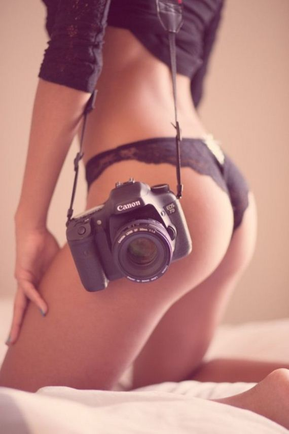 Sexy girl with a dslr camera stock photo