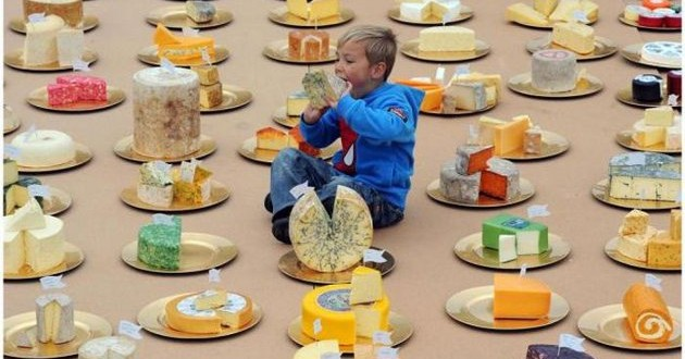 Four-year-old Aaron Ian Read takes a bite out of the World's Greatest Cheeseboard featuring over 150 different British cheeses. The cheeseboard has been created to show the variety and quality of British cheese as British Cheese Board research reveals the UK public's lack of knowledge about the cheese made on its doorstep. For further information please contact Ed Callow 020 7612 8860, Lucy Dormandy on 0207 612 8840 or email british.cheese@kindredagency.com.