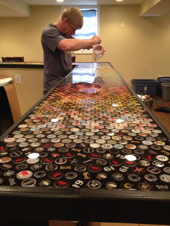 15-guy_makes_an_awesome_bottle_cap_bar_top