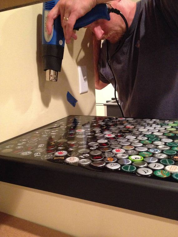 16-guy_makes_an_awesome_bottle_cap_bar_top
