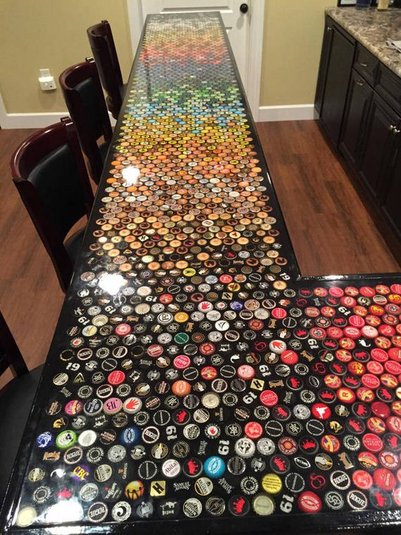 17-guy_makes_an_awesome_bottle_cap_bar_top