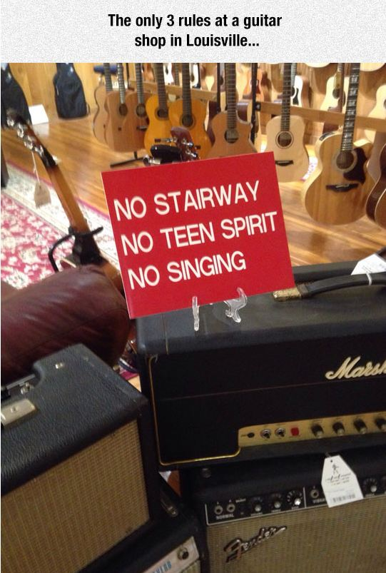 funny-guitar-shop-sign-no-singing