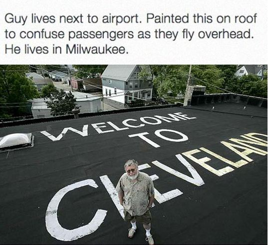 funny-man-painting-roof-cleveland